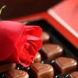 Stock Photo: Box of assorted chocolates and rose
