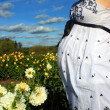 Pregnant woman&#039;s belly in the park - Stock Photo
