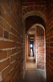 Narrow gallery with arches — Stock Photo
