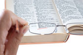 The dictionary and spectacles — Stock Photo