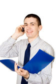 The young man speaks to phone — Stock Photo