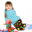 Stock Photo: Girl with meccano