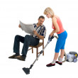 The husband, wife and a vacuum cleaner — Stock Photo