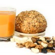 Royalty-Free Stock Photo: Orange juice, roll with bran and sesame