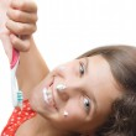 Beauty teen girl clean teeth isolated on white — Stock Photo