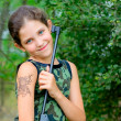 Girl with gun — Stockfoto