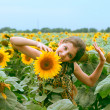 Stock Photo: Beauty teen girl and sunflower