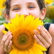 Beauty teen girl and sunflower — Stock Photo