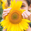 Beauty teen girl with sunflower — Stock Photo