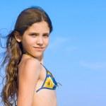 Beauty girl on sky background — Stock Photo