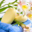 Soap and flower on blue fabric — Foto Stock