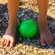 Child Feet on sand at green ball — Foto Stock