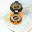 Compass and card - travel concept - Stockfoto