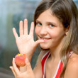 Smile Girl eat peach — Stock Photo