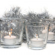 Silvery Tinsel and Three Candles - Stock Photo
