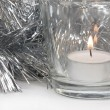 Silvery Tinsel and Candle - Stock Photo