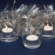 Silvery Tinsel and Three Candles — Stock Photo