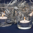 Royalty-Free Stock Photo: Silvery Tinsel and Three Candles