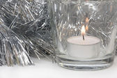 Silvery Tinsel and Candle — Stock Photo
