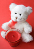 White Teddy Bear and Red Candle — Stock Photo
