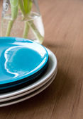 Clean Plates on Wooden Table — Stock Photo
