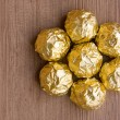 Stock Photo: Chocolate Candies in Gold Foil