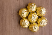 Chocolate Candies in Gold Foil — Stock Photo