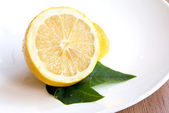 Juicy Lemon on the Plate — Stock Photo