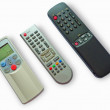 Three remote control units — 图库照片