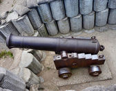 Ship gun in coastal shelter — Stock Photo