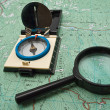 Stock Photo: Map, compass and magnifying glass