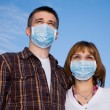 Couple wearing flu masks — Stock Photo