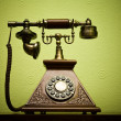 Stockfoto: The old phone with disc dials on the background wallpaper