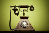The old phone with disc dials on the background wallpaper — Stockfoto