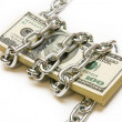 Shackled stack of dollars — Stock Photo