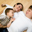 Family on a floor - Stockfoto