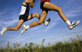 Flight of runners — Stock Photo