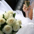 Bouquet of flowers and champagne — Stock Photo