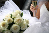 Bouquet of flowers and champagne — Stok fotoğraf