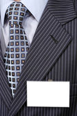 Official suit with blank badge on it. — Stock Photo