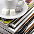 Royalty-Free Stock Photo: Cup of coffee on a pile of magazines.