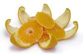 Slices of an orange on an orange peel. — Stock Photo