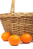 Tangerines and weaved basket. — Stock Photo
