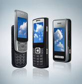 Three different types of mobile phones — Stock Photo