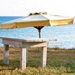 Beach umbrella and table — Stock Photo #1454962