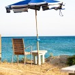 Stock Photo: Beach umbrelland chair