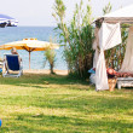 Gazebo with beach umbrella and chair — Stock Photo #1455283