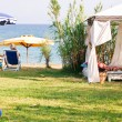 Stock Photo: Gazebo with beach umbrelland chair