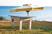 Beach umbrella and table — Stock Photo