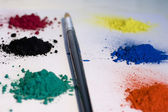 Pigments colors and paintbrush — Stock Photo